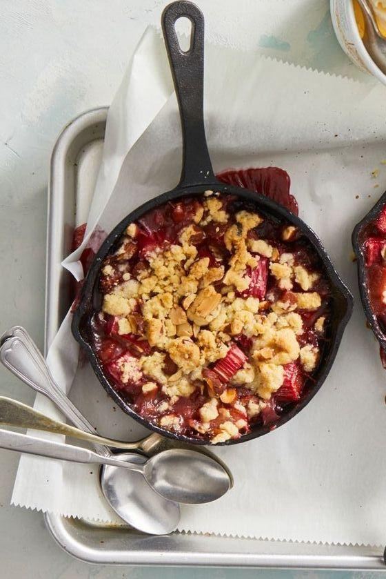 """<p>This rustic spring dessert is as delicious as any pie, but it comes together much more easily since you don't have to worry about making a crust.</p><p><em><a href=""""https://www.goodhousekeeping.com/food-recipes/a32020382/strawberry-rhubarb-crumble-recipe/"""" rel=""""nofollow noopener"""" target=""""_blank"""" data-ylk=""""slk:Get the recipe for Strawberry-Rhubarb Crumbles »"""" class=""""link rapid-noclick-resp"""">Get the recipe for Strawberry-Rhubarb Crumbles »</a></em></p>"""
