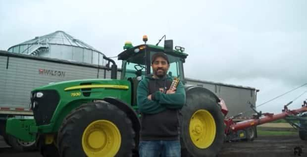 Vincent Pawluski built RCFarmArm, a remote-controlled tractor tool that he says will allow farmers to work more quickly with less stress. (Submitted by Vincent Pawluski - image credit)