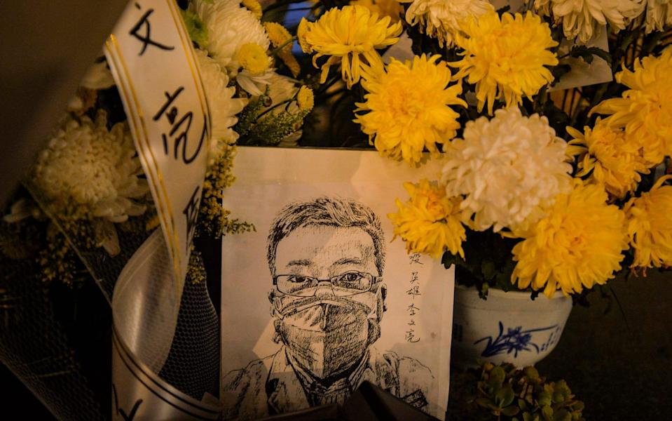 A card with a portrait of Dr Li Wenliang at a hospital in Wuhan in central China's Hubei province - Feature China/Barcroft Media via Getty Images