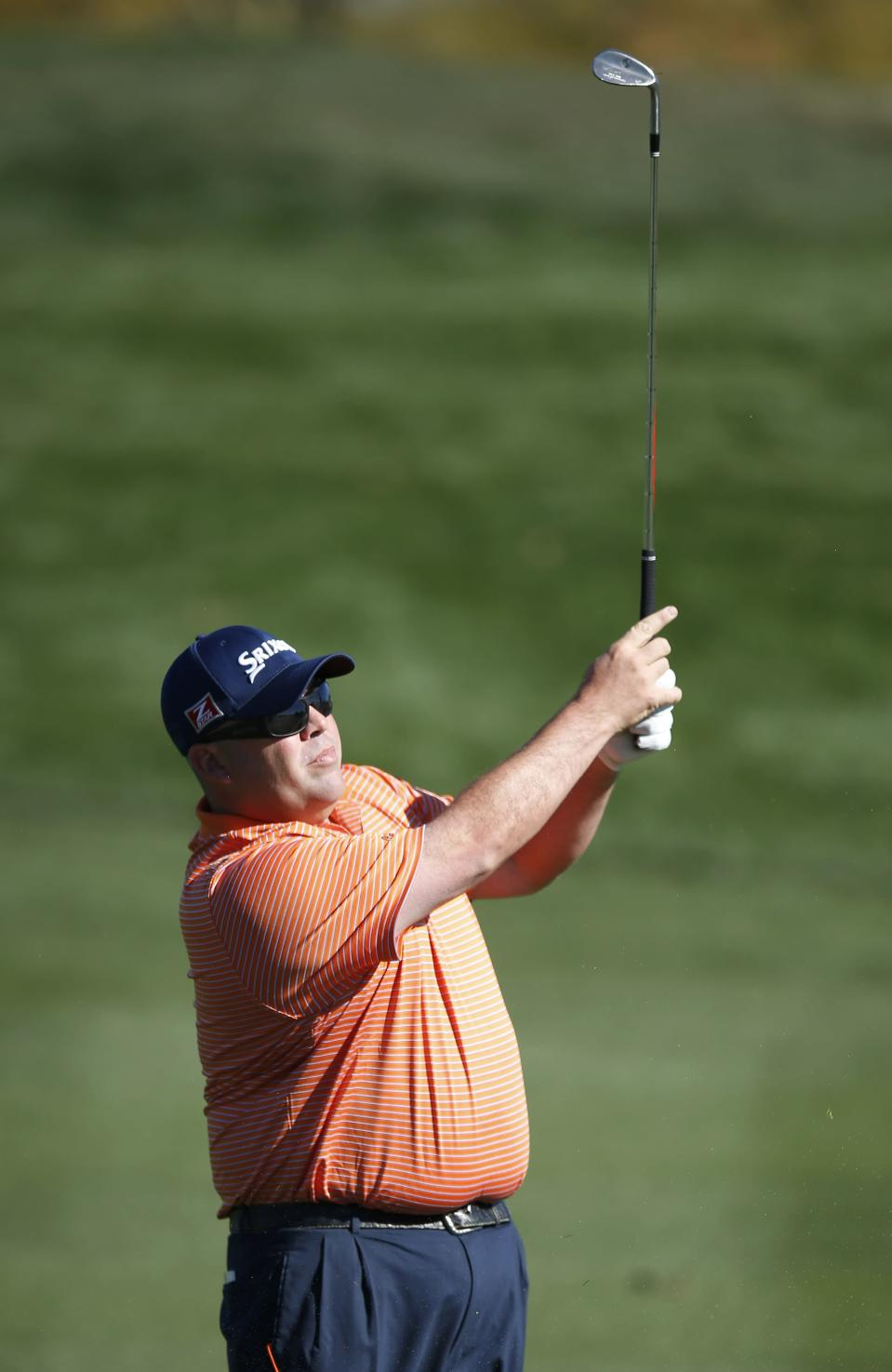 Kevin Stadler hits his approach shot onto the second green during the final round of the Phoenix Open golf tournament on Sunday, Feb. 2, 2014, in Scottsdale, Ariz. (AP Photo/Ross D. Franklin)