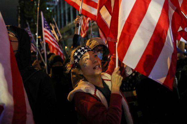 PHOTO: Protester holds a U.S. flag as she attends a rally in Hong Kong, China, Nov. 28, 2019. (Leah Millis/Reuters)