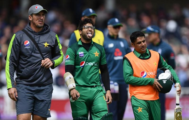 Imam-ul-Haq leaves the field injured before later returning.