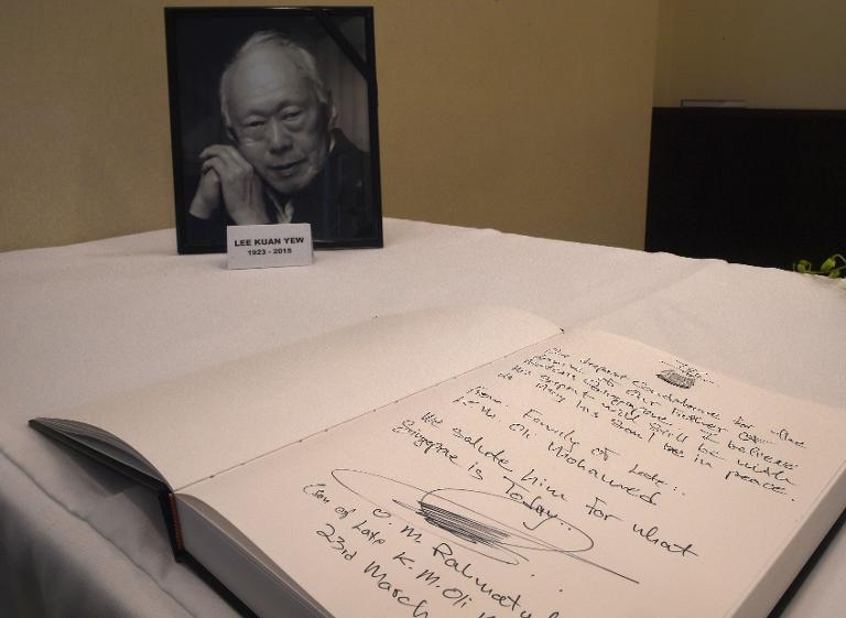 A portrait of Singapore's first prime minister Lee Kuan Yew on display next to a book of condolence at the Singapore High Commission in Kuala Lumpur, on March 23, 2015