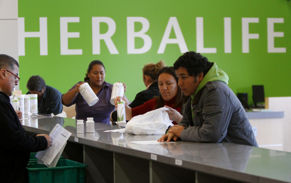 Distributors line-up at the main counter at the Herbalife Distribution Center in Carson, California January 24, 2013. (Photo by Mark Boster/Los Angeles Times via Getty Images)