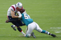 New England Patriots tight end Dalton Keene (44) fumbles the ball on a tackle by Miami Dolphins outside linebacker Jerome Baker (55), during the second half of an NFL football game, Sunday, Dec. 20, 2020, in Miami Gardens, Fla. (AP Photo/Joel Auerbach)