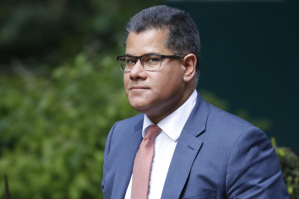 """Britain's Business Secretary Alok Sharma arrives at number 10 Downing Street in central London on May 12, 2020. - The British government on Monday published what it said was a """"cautious roadmap"""" to ease the seven-week coronavirus lockdown in England, notably recommending people wear facemasks in some public settings. (Photo by Tolga AKMEN / AFP) (Photo by TOLGA AKMEN/AFP via Getty Images)"""