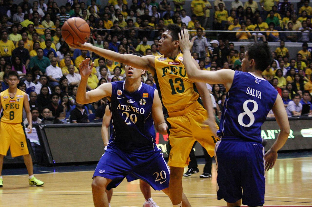 Cris Tolomia of FEU Tamaraws goes for the basket against Ateneo Blue Eagles during the UAAP Season 74 first game of the best-of-three championship series held at Smart Araneta Coliseum in Quezon City. (Marlo Cueto/NPPA Images)