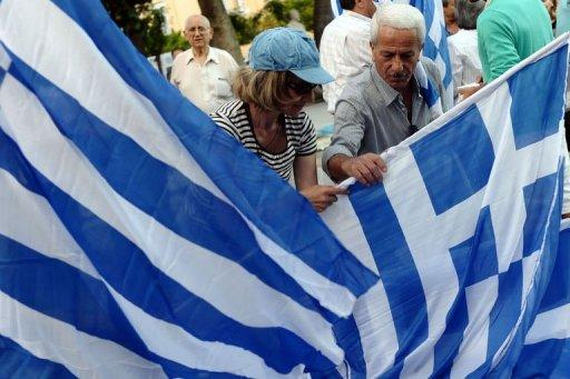 Supporters of Greek conservative party New Democracy distribute flags in Athens