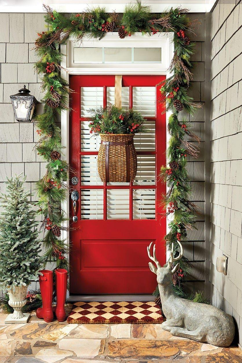 """<p>You've thought of door wreaths — but how about a door <em>basket</em>? Baskets filled with holiday branches make cozy decor on a door, tabletop, or in freestanding arrangements.<br></p><p><strong><em>Get the look at <a href=""""https://go.redirectingat.com?id=74968X1596630&url=https%3A%2F%2Fwww.ballarddesigns.com%2Fhowtodecorate%2F2015%2F10%2F7-ways-to-cheer-up-your-entryway-for-the-holidays%2F&sref=https%3A%2F%2Fwww.womansday.com%2Fhome%2Fg37599158%2Fchristmas-porch-decorations%2F"""" rel=""""nofollow noopener"""" target=""""_blank"""" data-ylk=""""slk:Ballard Designs"""" class=""""link rapid-noclick-resp"""">Ballard Designs</a>. </em></strong></p>"""