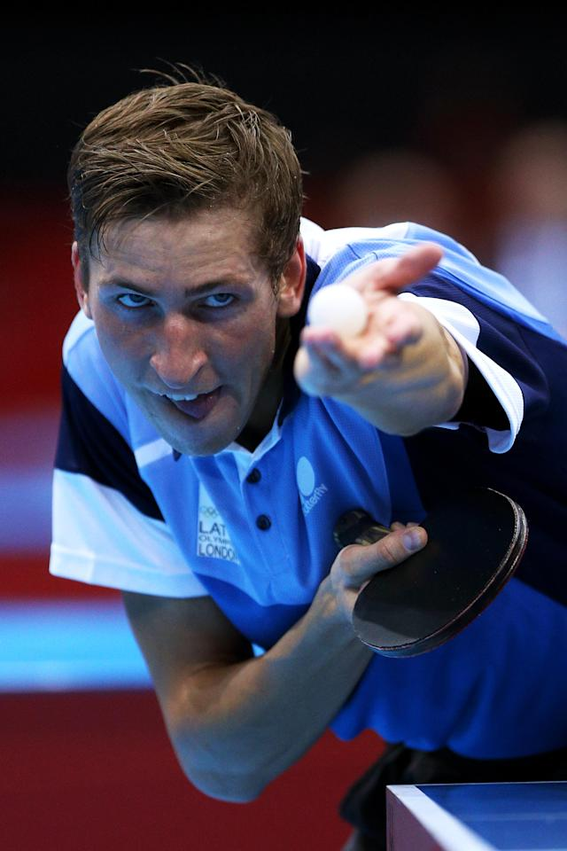 LONDON, ENGLAND - JULY 28: Matiss Burgis of Latvia serves against Pierre-Luc Hinse of Canada during their Men's Singles Table Tennis match on Day 1 of the London 2012 Olympic Games at ExCeL on July 28, 2012 in London, England. (Photo by Feng Li/Getty Images)