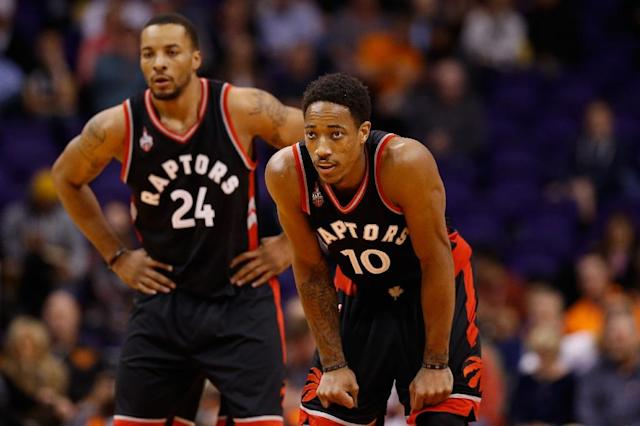 DeMar DeRozan (R) and Norman Powell of the Toronto Raptors look down court during a NBA game at Talking Stick Resort Arena in Phoenix, Arizona, in February 2016 (AFP Photo/Christian Petersen)