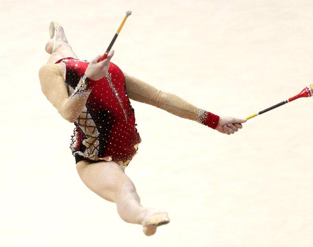 Azerbaijan's Anna Gurbanova performs during the individual clubs competition at the 27th Rhythmic Gymnastics European Championship in Minsk, May 28, 2011. (REUTERS/Vasily Fedosenko)