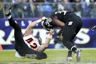 <p>Running back Kenneth Dixon #30 of the Baltimore Ravens is tackled by safety Clayton Fejedelem #42 of the Cincinnati Bengals in the third quarter at M&T Bank Stadium on November 27, 2016 in Baltimore, Maryland. (Photo by Patrick Smith/Getty Images) </p>
