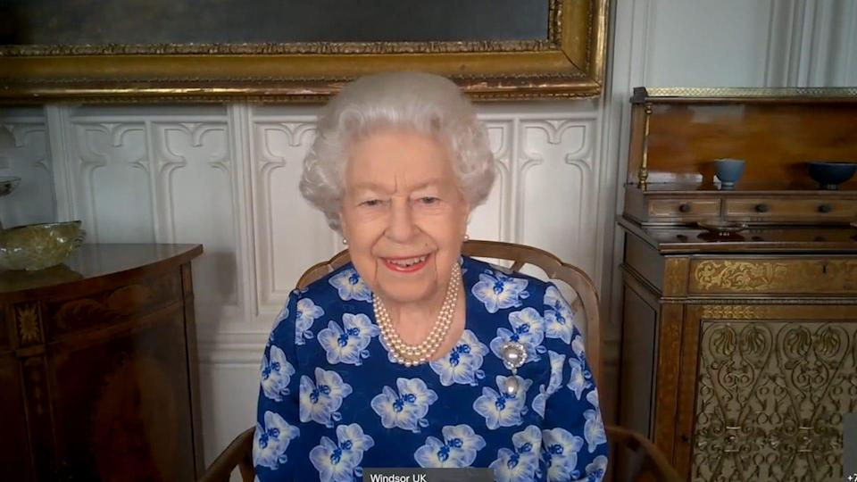 Queen Elizabeth II speaks via video conference from Windsor Castle to thank volunteers with the Royal Voluntary Service, March 19, 2021.