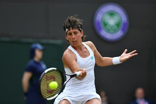 Suarez Navarro was thrashed by Serena Williams in the Wimbledon last 16 earlier this year (AFP Photo/GLYN KIRK)