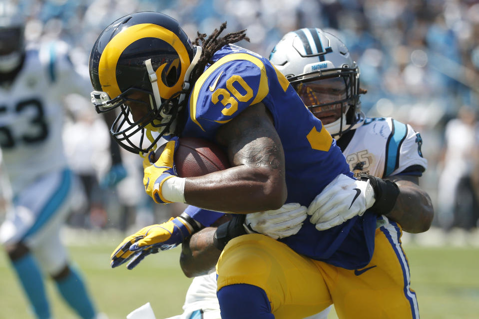 Carolina Panthers outside linebacker Shaq Thompson tackles Los Angeles Rams running back Todd Gurley (30) during the first half of an NFL football game in Charlotte, N.C., Sunday, Sept. 8, 2019. (AP Photo/Brian Blanco)