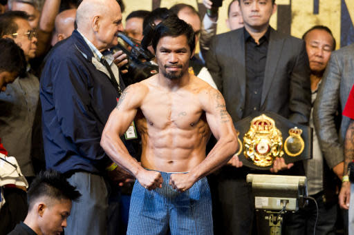 Philippine senator and boxing hero Manny Pacquiao poses after weigh-in in Kuala Lumpur, Malaysia, Saturday, July 14, 2018. Matthysse and Pacquiao are scheduled to fight on July 15, for the World Boxing Association welterweight title in Malaysia. (AP Photo/Yam G-Jun)