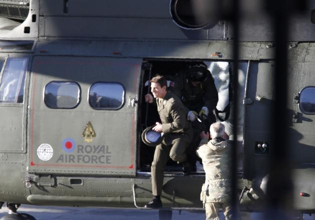 Tom Cruise is spotted flying in and RAF helicopter on set for the movie 'All You Need Is Kill' being filmed in Trafalgar Square, London, on November 25, 2012 --