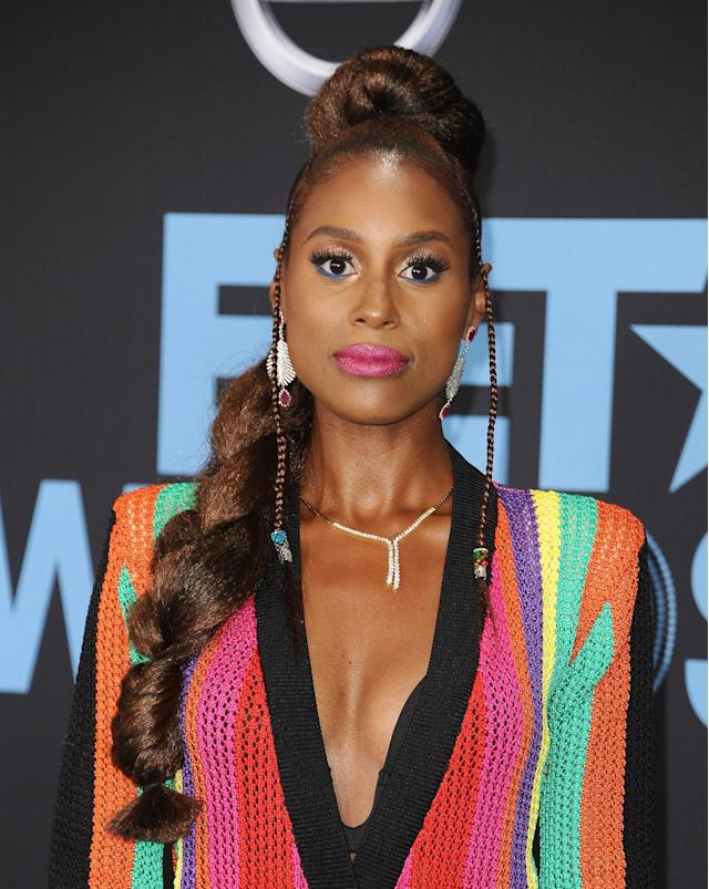 <p>Issa Rae has truly wowed us again! A pink lip that pops, braided updo that deserves a round of applause in itself and doll-like lashes that are almost hypnotizing – sheesh, girl! (Photo: Getty) </p>