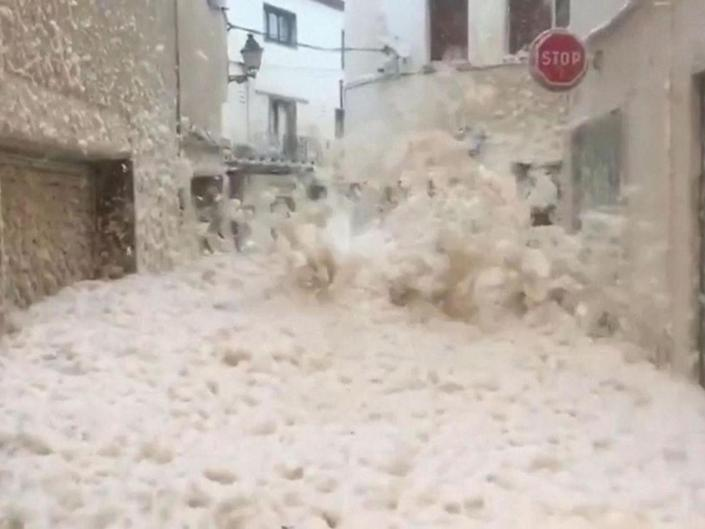 The Spanish town of Tossa del Mar has been inundated with sea foam amid a deadly storm