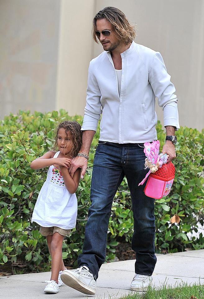 "Later in the week, Nahla got in a little time with her dad, Gabriel Aubrey. Halle and Gabriel split three years ago and have been embroiled in a custody battle that culminated in <a href=""http://omg.yahoo.com/news/gabriel-aubry-vs-olivier-martinez--the-conflicting-stories-about-their-fight-003640257.html"" target=""_blank"">a headline-making altercation over Thanksgiving weekend</a>, but things seem to be a bit more peaceful between them these days. (5/17/2013)"