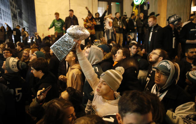 <p>Philadelphia Eagles fans celebrate the team's victory in the NFL Super Bowl 52 between the Philadelphia Eagles and the New England Patriots, Sunday, Feb. 4, 2018, in downtown Philadelphia. (AP Photo/Matt Rourke) </p>