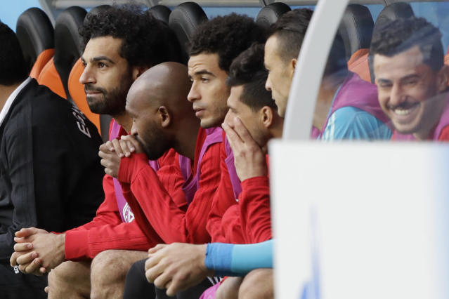 Egypt's Mohamed Salah, left, sits on the bench during the group A match between Egypt and Uruguay at the 2018 soccer World Cup in the Yekaterinburg Arena in Yekaterinburg, Russia, Friday, June 15, 2018. (AP Photo/Mark Baker)