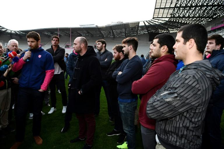 Stade Francais players, pictured here speaking to journalists in Paris on March 13, 2017, voted overwhelmingly to strike and refused to train or play this season after a shock merger was announced between their side and rivals Racing 92