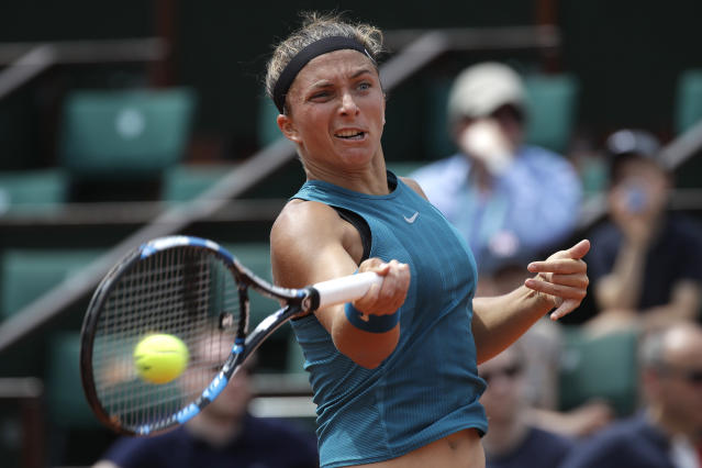 FILE - In this Sunday, May 27, 2018 file photo, Italy's Sara Errani returns the ball to France's Alize Cornet during their first round match of the French Open tennis tournament at the Roland Garros Stadium, in Paris. 2012 French Open finalist Sara Errani's doping suspension has been increased from two months to 10 months by the Court of Arbitration for Sport. CAS announced on Monday, June 11, its rulings in appeals by Errani and Italy's national anti-doping agency, which asked for up to a two-year punishment. (AP Photo/Alessandra Tarantino, file)