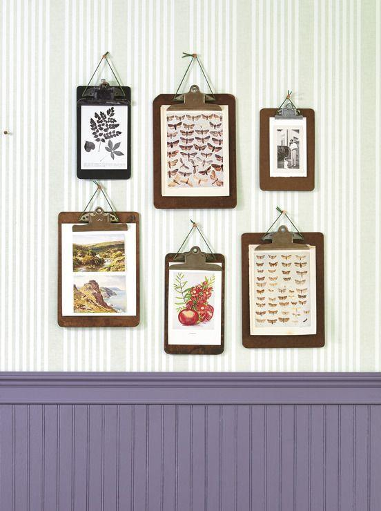 <p>When it comes to gallery walls, frames can get expensive. For this arrangement, simply clip prints to vintage clipboards. Thread a piece of leather jewelry cord under the clip, knot it at the top, and hang with a pushpin.</p>