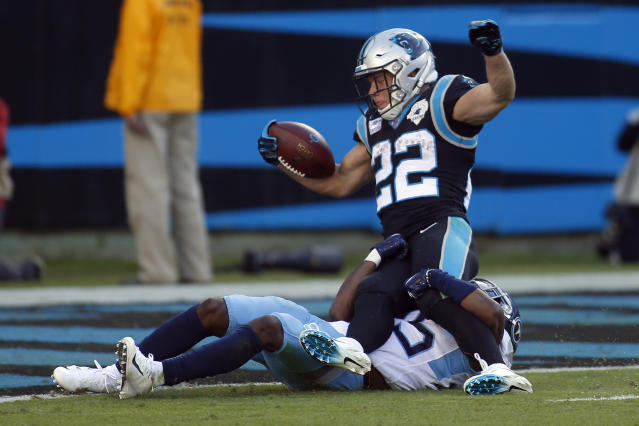 Carolina Panthers running back Christian McCaffrey (22) scores a touchdown while Tennessee Titans cornerback Adoree' Jackson (25) tackles during the second half of an NFL football game in Charlotte, N.C., Sunday, Nov. 3, 2019. (AP Photo/Brian Blanco)