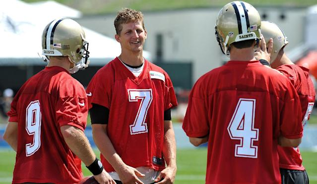 New Orleans Saints quarterbacks Drew Brees (9) Luke McCown (4) and Ryan Griffin (7) talk during training camp in White Sulphur Springs, W. Va., Friday, July 25, 2014. (AP Photo/Chris Tilley)