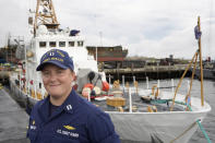 """U.S. Coast Guard Lt. Kelli Normoyle, Commanding Officer of the Coast Guard Cutter Sanibel, stands for a photograph near the vessel, Thursday, Sept. 16, 2021, at a shipyard in North Kingstown, R.I. Normoyle was one of two cadets who formally started the process to create the CGA Spectrum Diversity Council just a few months after the law known as """"don't ask, don't tell"""" was repealed on Sept. 20, 2011. (AP Photo/Steven Senne)"""