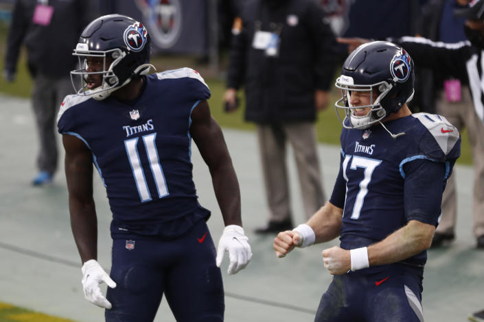 Tennessee Titans quarterback Ryan Tannehill celebrates after scoring during the first half of an NFL football game against the Detroit Lions Sunday, Dec. 20, 2020, in Nashville, N.C. (AP Photo/Wade Payne)