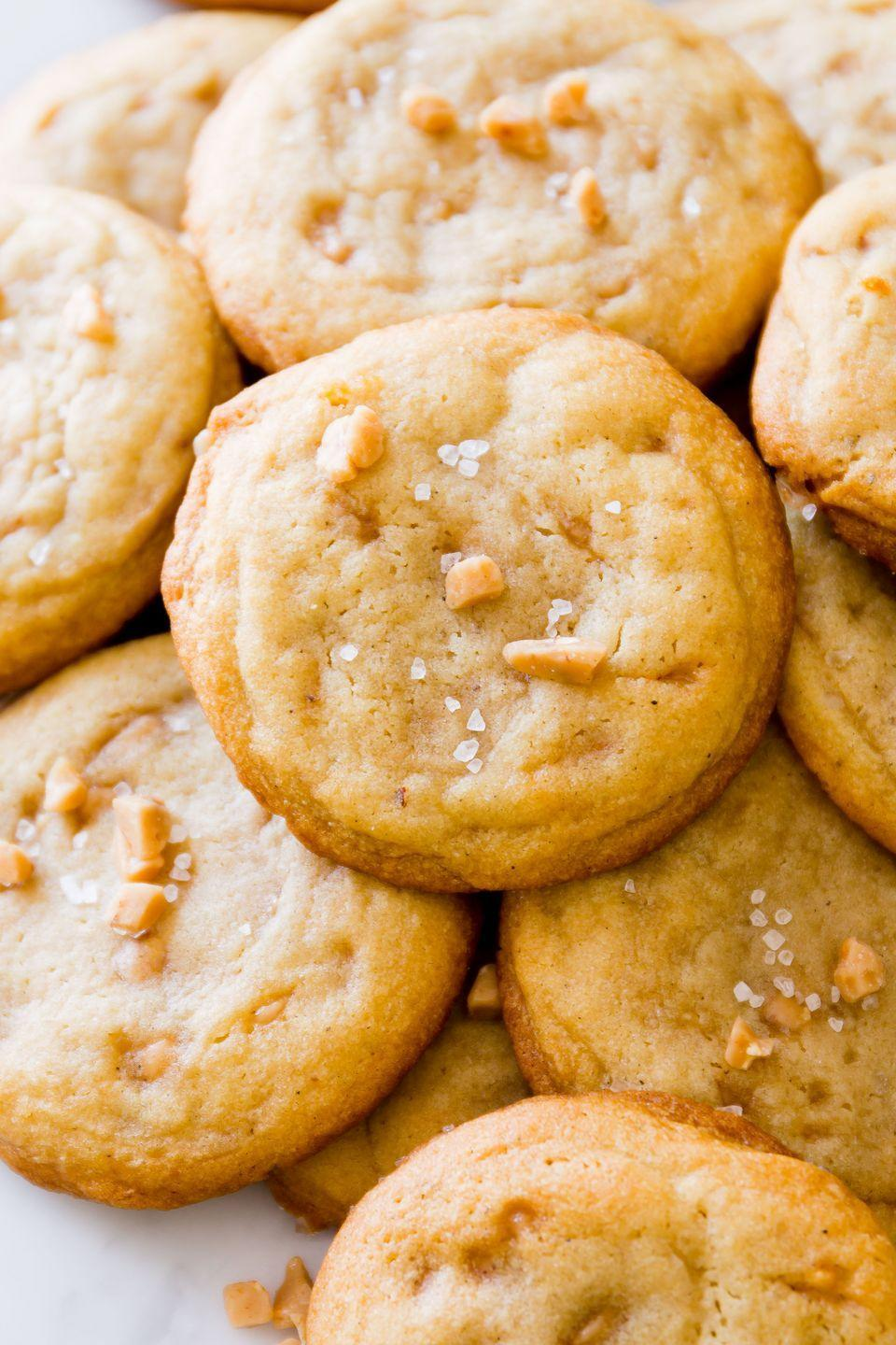 """<p>These cookies have mass appeal thanks to their supreme buttery flavor, the bits of toffee in every bite, and the sprinkle of sea salt on top. </p><p>Get the recipe from <a href=""""https://www.delish.com/cooking/a42774/best-salted-vanilla-toffee-cookies-recipe/"""" rel=""""nofollow noopener"""" target=""""_blank"""" data-ylk=""""slk:Delish"""" class=""""link rapid-noclick-resp"""">Delish</a>.</p>"""