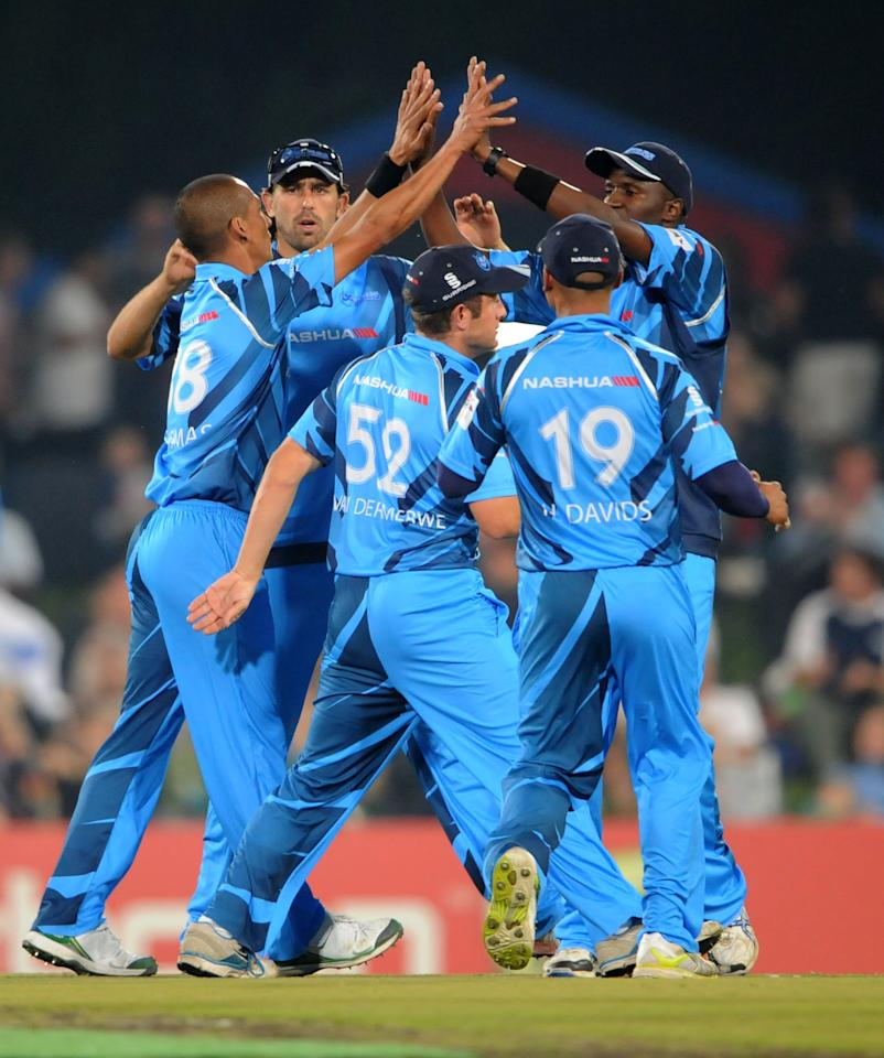 PRETORIA, SOUTH AFRICA - OCTOBER 26: (SOUTH AFRICA OUT) Titans celebrate the wicket of Michael Lumb during the Karbonn Smart CLT20 Semi Final match between Nashua Titans and Sydney Sixers at SuperSport Park on October 26, 2012 in Pretoria, South Africa. (Photo by Lee Warren/Gallo Images/Getty Images)