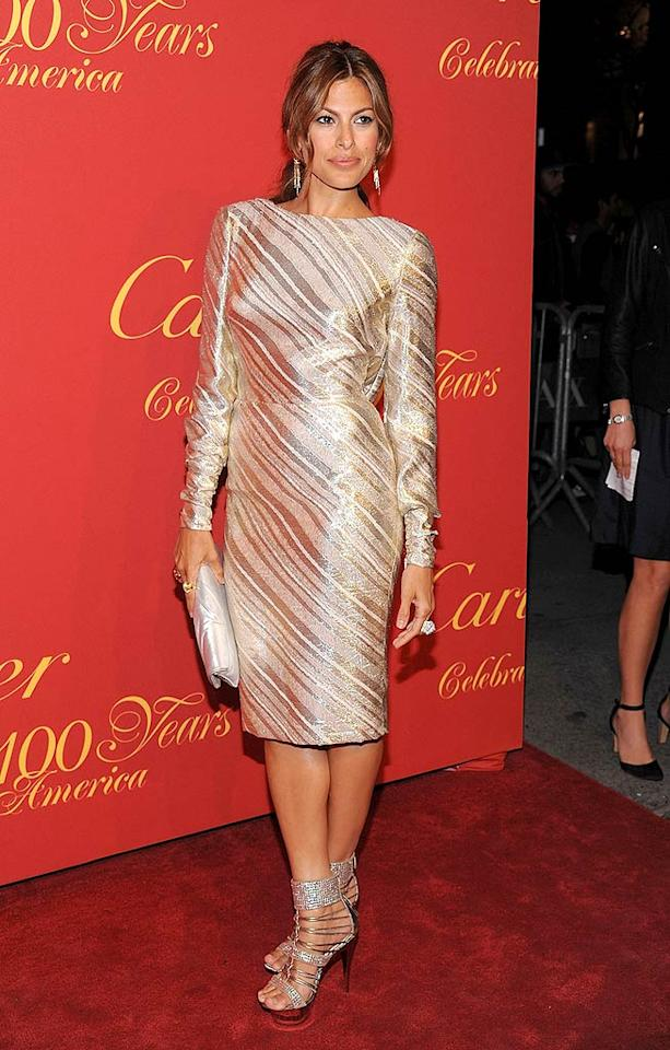 "Also in attendance? Eva Mendes, who sparkled in a gold metallic long-sleeved Azzaro dress, bedazzled Giuseppe Zanotti sandals, and Cartier jewels. Dimitrios Kambouris/<a href=""http://www.wireimage.com"" target=""new"">WireImage.com</a> - April 30, 2009"