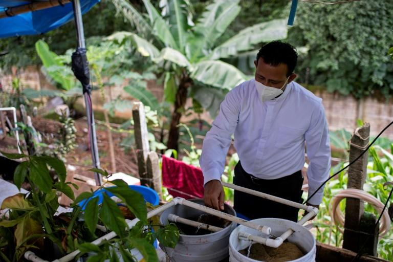 El Salvador children, priest launch initiatives to stave off hunger
