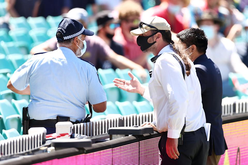 SYDNEY, AUSTRALIA - JANUARY 10: Police talk to security regarding an onfield complaint by Mohammed Siraj of India during day four of the Third Test match in the series between Australia and India at Sydney Cricket Ground on January 10, 2021 in Sydney, Australia. (Photo by Cameron Spencer/Getty Images)