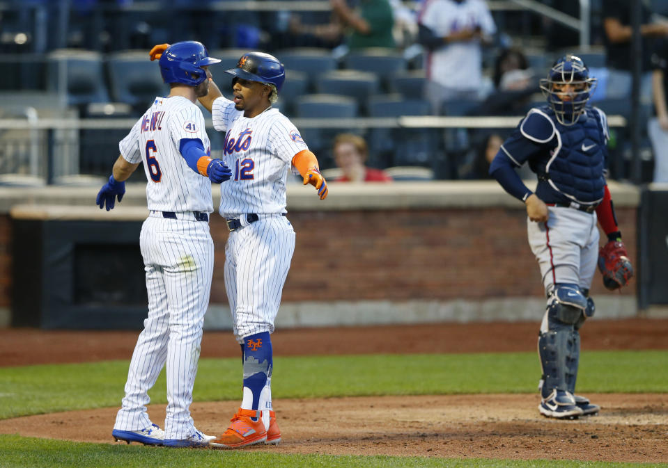 New York Mets third baseman Jeff McNeil (6) and shortstop Francisco Lindor (12) celebrate after scoring against the Atlanta Braves during the second inning of a baseball game. Wednesday, June 23, 2021, in New York. (AP Photo/Noah K. Murray)