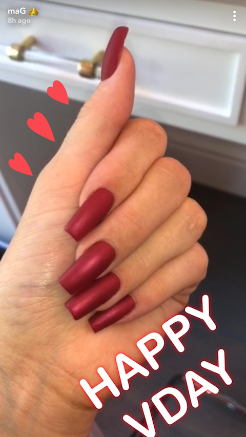 <p>The queen of coffin nails celebrated Valentine's Day by bringing back the matte nail trend. She rocked a toned-down shade of blood red and shared a pic on Snapchat. </p>
