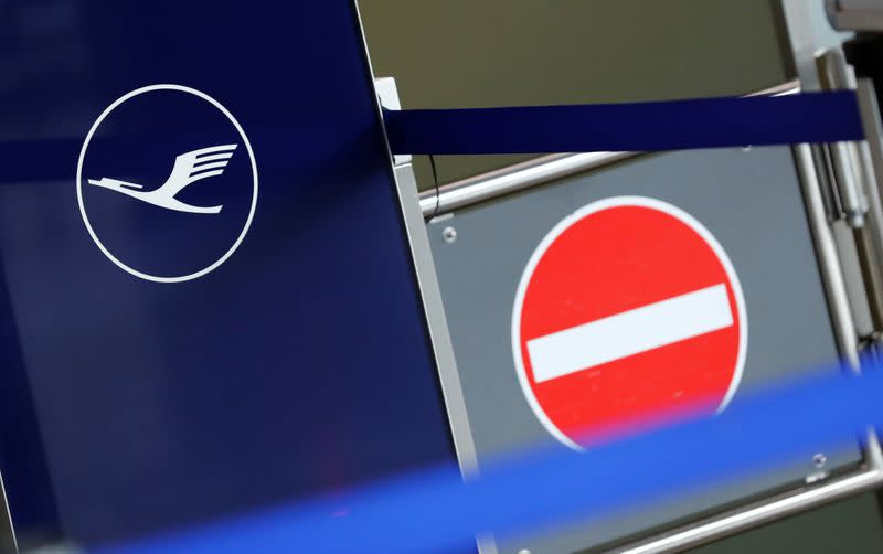 Logo of German airlines Lufthansa is pictured next to a no-entry sign at Frankfurt Airport