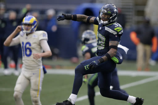 Seattle Seahawks strong safety Jamal Adams (33) reacts to a play with Los Angeles Rams quarterback Jared Goff (16) in the background, during the second half of an NFL football game, Sunday, Dec. 27, 2020, in Seattle. (AP Photo/Scott Eklund)