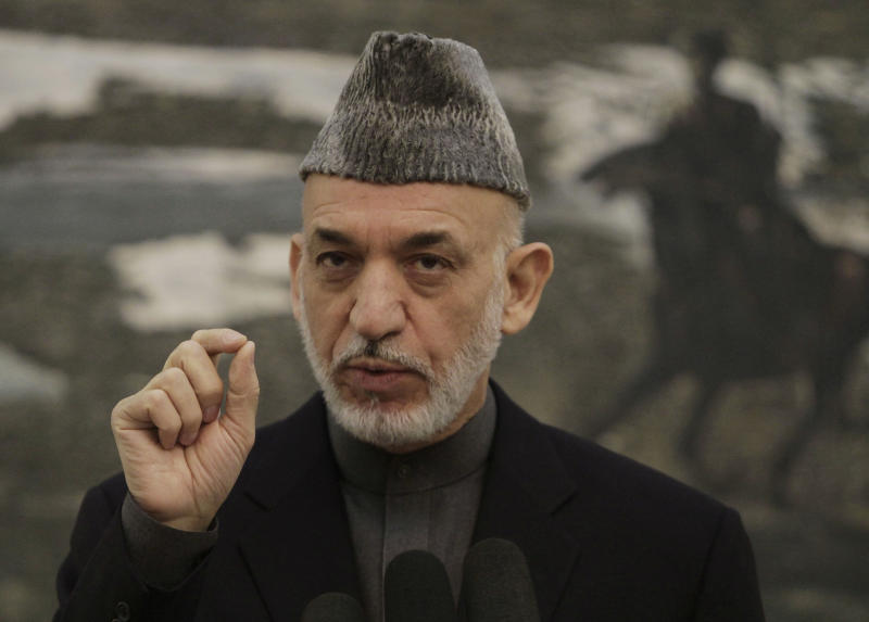 Afghan President Hamid Karzai gestures during a press conference at the presidential palace in Kabul, Saturday, Nov. 16, 2013. Karzai announced that the final draft of a contentious Bilateral Security Agreement with the United States has been completed ahead of a traditional loya Jirga, or grand council, convened to discuss the critical pact. Both countries have signed off on the draft. (AP Photo/Rahmat Gul)