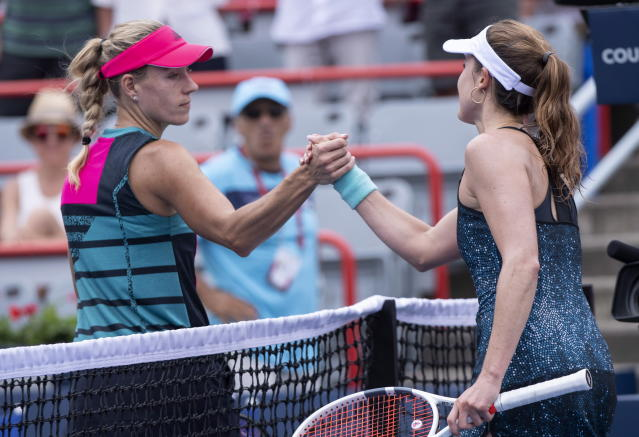 Angelique Kerber, left, of Germany, congratulates Elize Cornet, of France, after their match at the Rogers Cup women's tennis tournament, Wednesday, Aug. 8, 2018, in Montreal. (Paul Chiasson/The Canadian Press via AP)