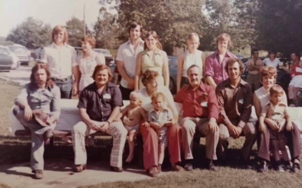 Charlie Gammage (front row, second from the left) sits with his family at a reunion in Fergus, Ont.