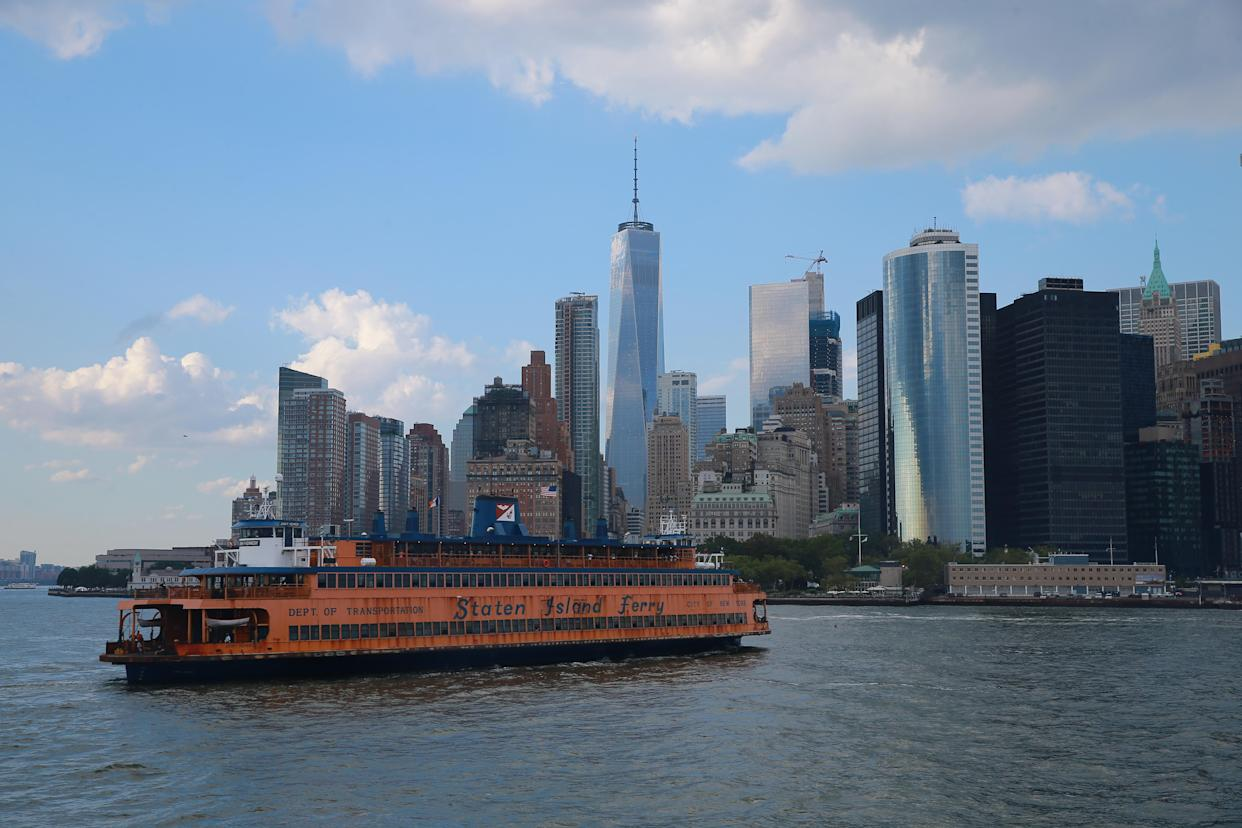 Outer borough: A Staten Island Ferry heads to lower Manhattan with One World Trade Center in the background last August. (Photo: Gordon Donovan/Yahoo News)