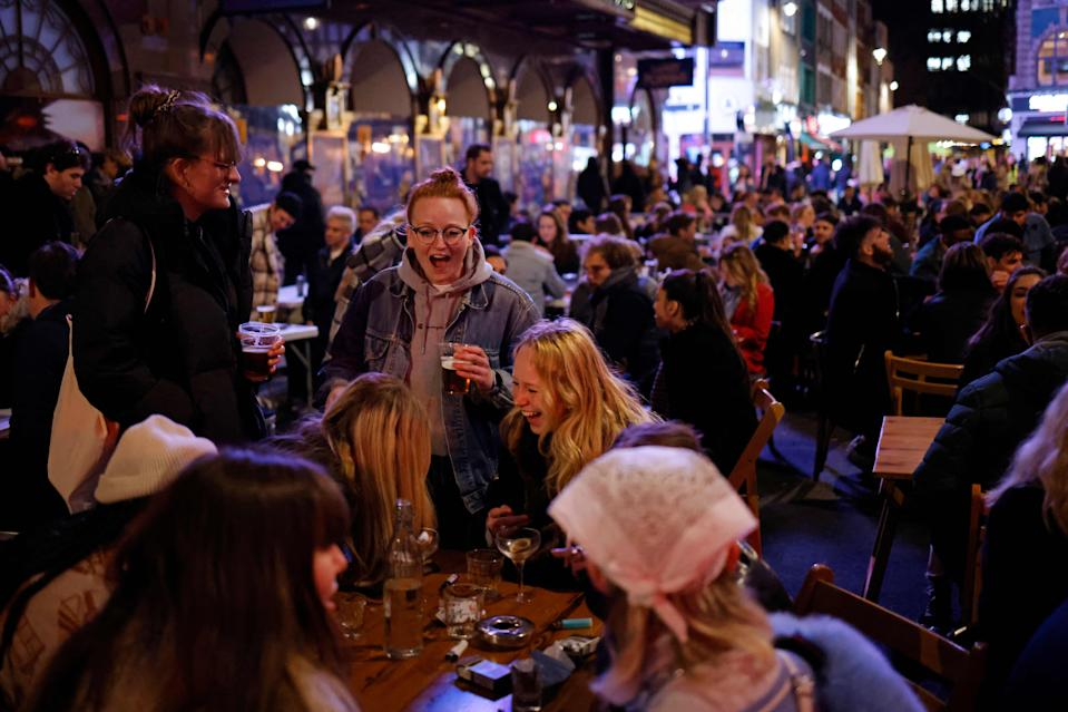 Drinkers outside in Soho, London on Monday night as pubs reopened after lockdown (AFP via Getty Images)