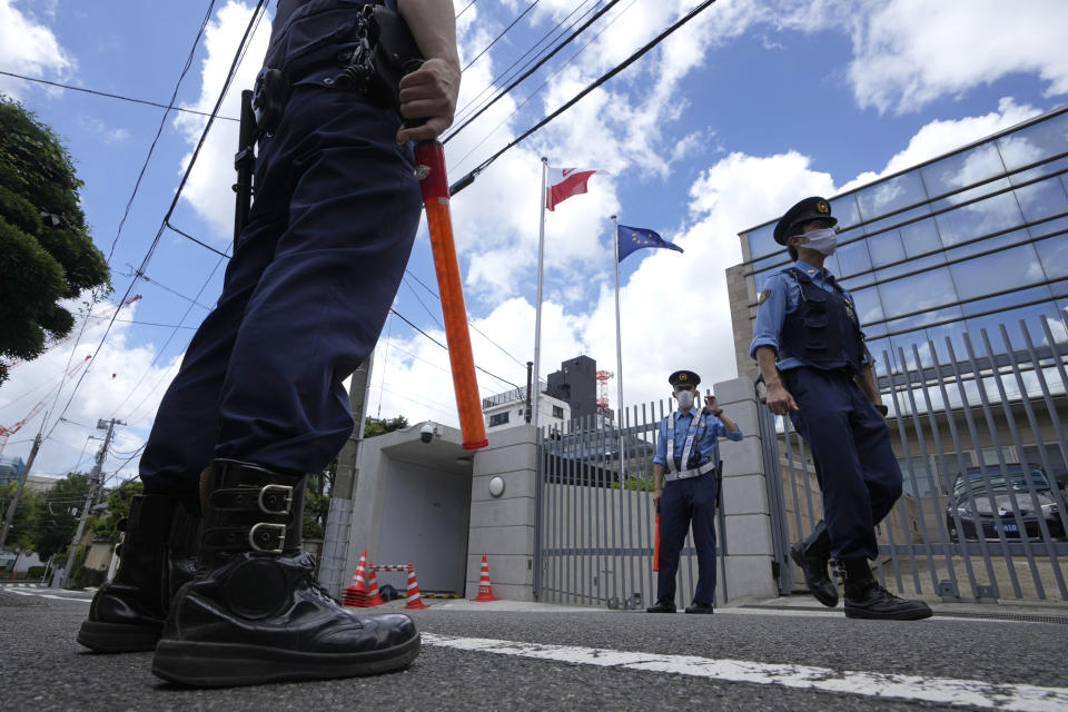 Police officers guard outside the Poland Embassy Tuesday, Aug. 3, 2021, in Tokyo, Japan. Poland granted a visa Monday to a Belarusian Olympic sprinter Krystsina Tsimanouskaya who said she feared for her safety and that her team's officials tried to force her to fly home, where the autocratic government was accused of diverting a flight to arrest a dissident journalist.(AP Photo/Shuji Kajiyama)