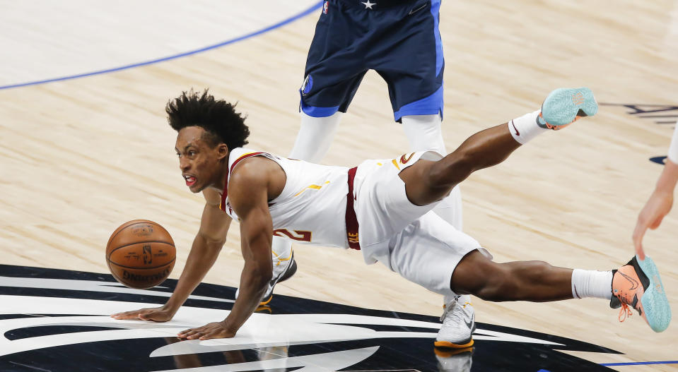 Cleveland Cavaliers guard Collin Sexton (2) is fouled by Dallas Mavericks forward Dorian Finney-Smith during the first half of an NBA basketball game, Friday, May 7, 2021, in Dallas. (AP Photo/Brandon Wade)
